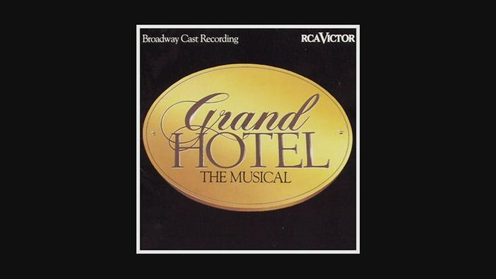 Checks into the Grand Hotel